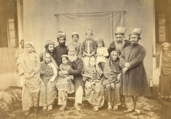 Studio portrait of a large Parsee family group, Bombay.